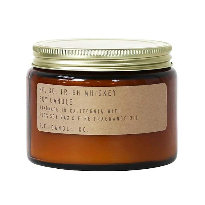 """<p>A candle for the rustic whiskey-lovers in our life — P.F. Candle Co.'s amber votive contains rich notes of pear, honey, and whiskey layered with vanilla and tonka.</p><br><br><strong>P.F. Candle Co.</strong> No. 30: Irish Whiskey Candle (Double Wick 14 oz), $38, available at <a href=""""https://www.amazon.com/P-F-Candle-Co-Whiskey-Double/dp/B079S77SD9/ref=sr_1_1_sspa?ie=UTF8&qid=1541526162&sr=8-1-spons&keywords=p+f+candle+co&psc=1"""" rel=""""nofollow noopener"""" target=""""_blank"""" data-ylk=""""slk:Amazon"""" class=""""link rapid-noclick-resp"""">Amazon</a>"""