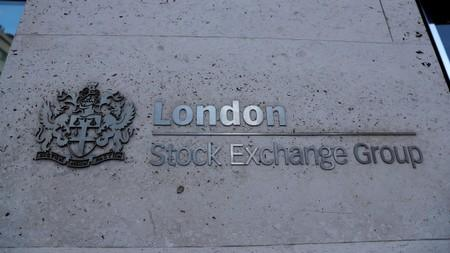 Signage is seen outside the entrance of the London Stock Exchange in London