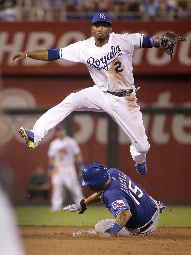 Kansas City Royals shortstop Alcides Escobar throws to first for the double play hit into by Texas Rangers' Leonys Martin after forcing Michael Choice (15) out second during the seventh inning of a baseball game Monday, Sept. 1, 2014, in Kansas City, Mo. (AP Photo/Charlie Riedel)