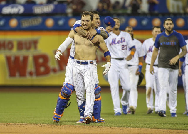 Michael Conforto has lost his shirt but the Mets won the game, 7-6, on Conforto's walk-off single in the bottom of the ninth Friday night at Citi Field (USA Today Sports)