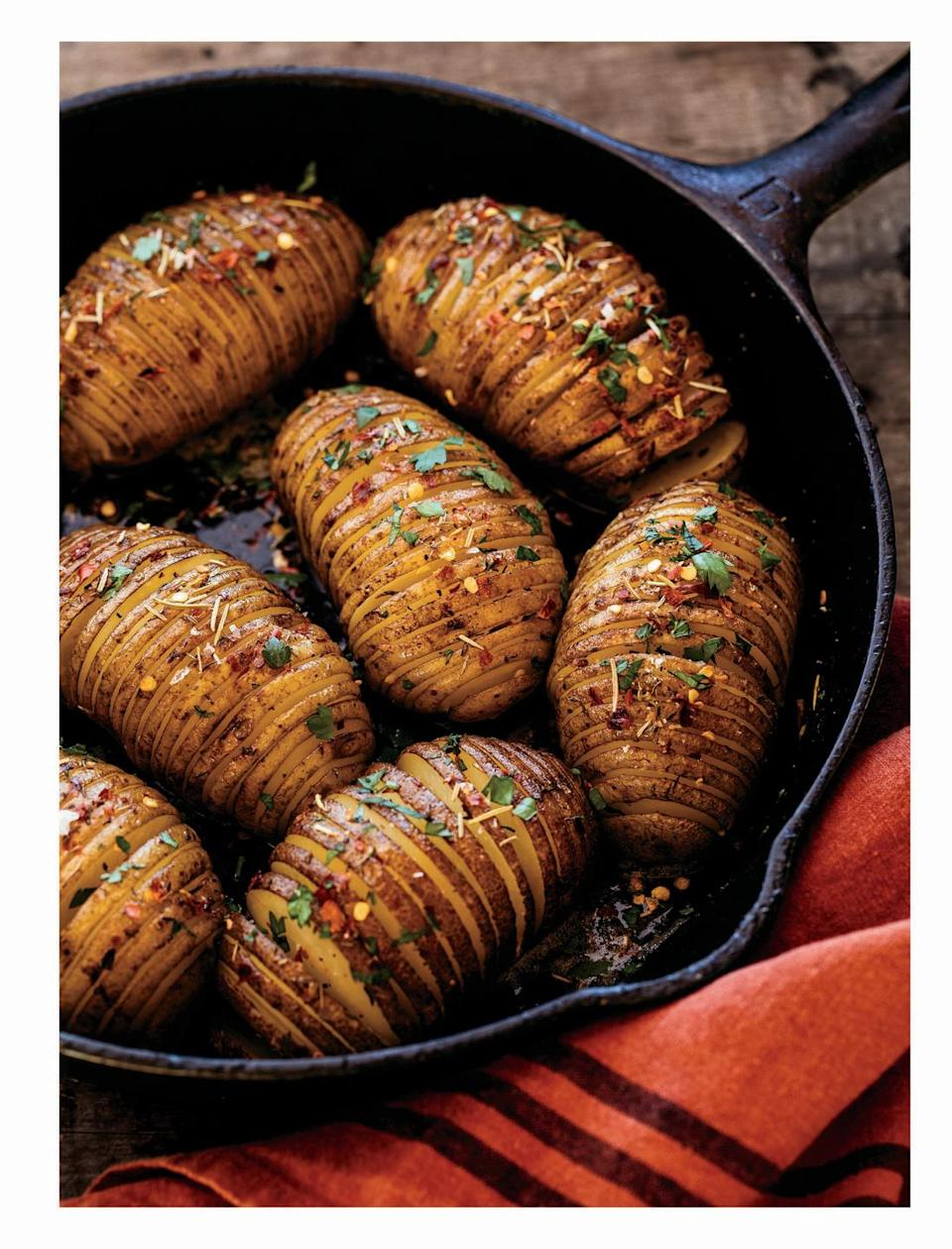 "<p>Slip these amazing-looking potatoes onto everyone's plates and your guests will be impressed first by how good they look, and second by how good they taste. But they're not difficult to make.</p><p><strong><a href=""https://www.countryliving.com/food-drinks/a34277029/cast-iron-hasselback-potatoes/"" rel=""nofollow noopener"" target=""_blank"" data-ylk=""slk:Get the recipe"" class=""link rapid-noclick-resp"">Get the recipe</a>.</strong></p><p><a class=""link rapid-noclick-resp"" href=""https://www.amazon.com/Victoria-Skillet-Seasoned-Flaxseed-Certified/dp/B01726HD72/?tag=syn-yahoo-20&ascsubtag=%5Bartid%7C10050.g.1078%5Bsrc%7Cyahoo-us"" rel=""nofollow noopener"" target=""_blank"" data-ylk=""slk:SHOP CAST IRON PANS"">SHOP CAST IRON PANS</a></p>"