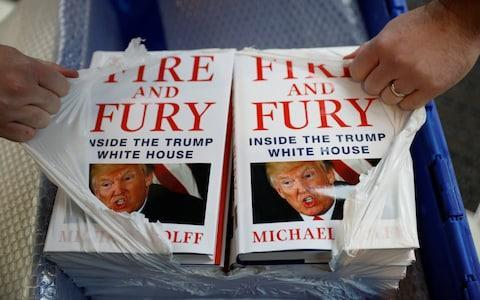 A shop worker opens a package containing copies of Michael Wolff's book 'Fire And Fury' as they go on sale inside a branch of the Waterstones book store in Liverpool, Britain, January 11, 2018. REUTERS/Phil Noble - Credit: PHIL NOBLE/REUTERS