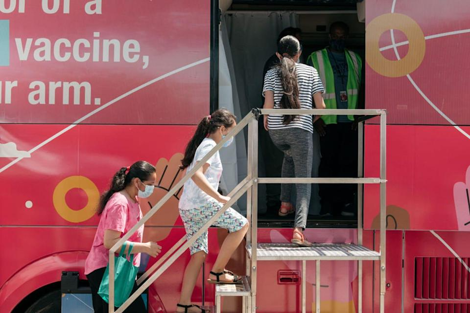 A family enters a pop-up COVID-19 vaccine site on June 5, 2021, in the Jackson Heights neighborhood in the Queens borough in New York City.