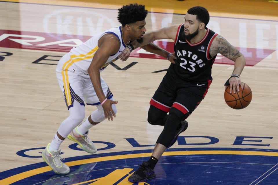 Toronto Raptors guard Fred VanVleet (23) is defended by Golden State Warriors guard Quinn Cook during the first half of Game 3 of basketball's NBA Finals in Oakland, Calif., Wednesday, June 5, 2019. (AP Photo/Tony Avelar)