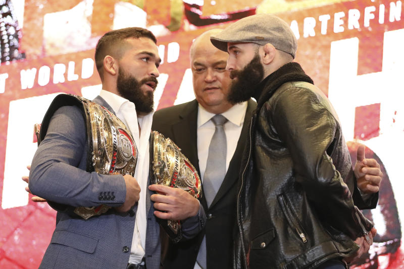 Patricio 'Pitbull' Freire, left, squares off with Pedro Carvalho at a news conference promoting the Bellator Spring & Summer fight cards on Monday, March 9, 2020, in New York City. (AP Photo/Gregory Payan)