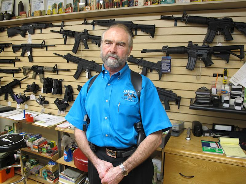 <p> Frank Loane, owner of Pasadena Pawn and Gun, stands in front of a wall of assault rifles at his store in Pasadena, Md., on Thursday, Sept. 26, 2013. Loane, who said he has seen significant boost in business this year as Maryland lawmakers debated and passed a sweeping gun-control bill, won't be able to sell many of the guns shown behind him in Maryland after Tuesday, when the gun-control law takes effect banning 45 types of assault weapons. Loane also says handgun sales have been up, because customers don't want to meet a new fingerprinting requirement to buy a handgun on Oct. 1, as well as additional paperwork and a gun safety course. (AP Photo/Brian Witte)