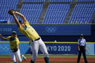Australia's Clare Warwick (2) catches a fly ball hit by United States' Valerie Arioto for an out in the fourth inning of a softball game at the 2020 Summer Olympics, Sunday, July 25, 2021, in Yokohama, Japan. (AP Photo/Sue Ogrocki)