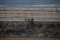 South Korean soldiers work in front of a military fence near the demilitarized zone separating the two Koreas in Paju