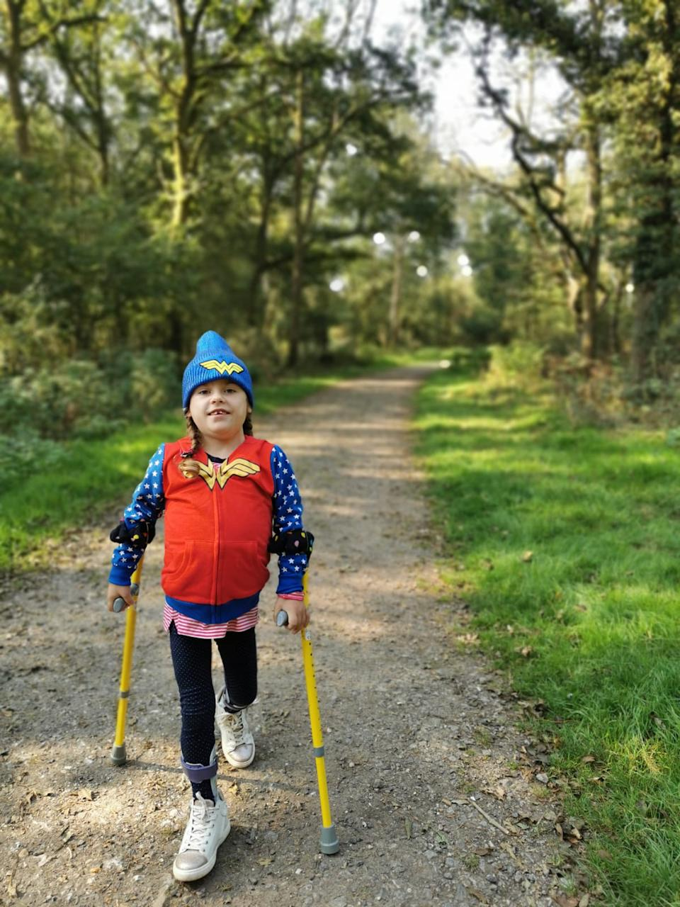 Carmela walks with the aid of sticks (Muscular Dystrophy UK/PA).