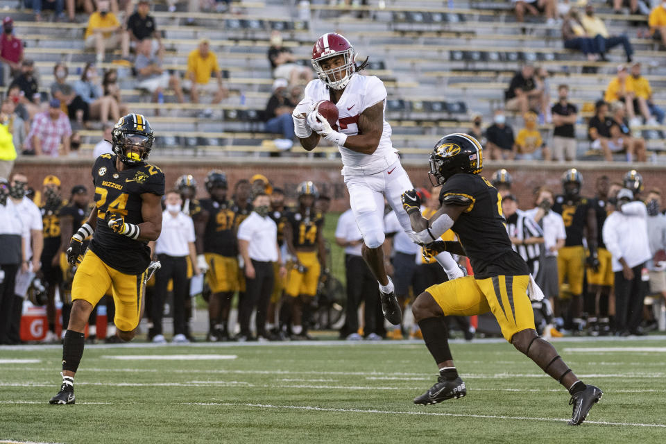 Alabama wide receiver Jaylen Waddle, center, pulls down a reception between Missouri's Tyree Gillespie, right, and Ishmael Burdine, left, during the first quarter of an NCAA college football game Saturday, Sept. 26, 2020, in Columbia, Mo. (AP Photo/L.G. Patterson)