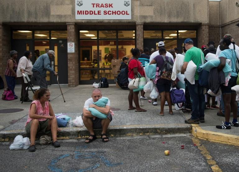 People line up to enter a hurricane shelter at Trask Middle School in Wilmington, North Carolina