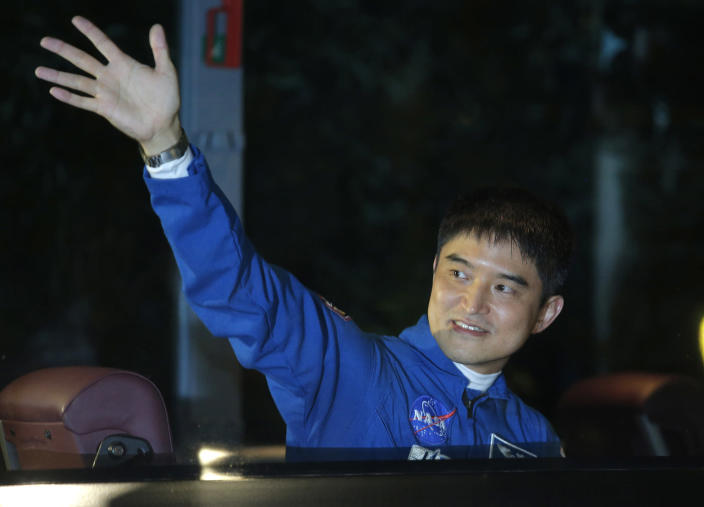 <p>Japanese astronaut Takuya Onishi, a member of the main crew to the International Space Station (ISS), waves to his relatives from a bus prior to the launch of the Soyuz-FG rocket at the Russian leased Baikonur cosmodrome, in Kazakhstan, Thursday, July 7, 2016. (AP Photo/Dmitri Lovetsky) </p>