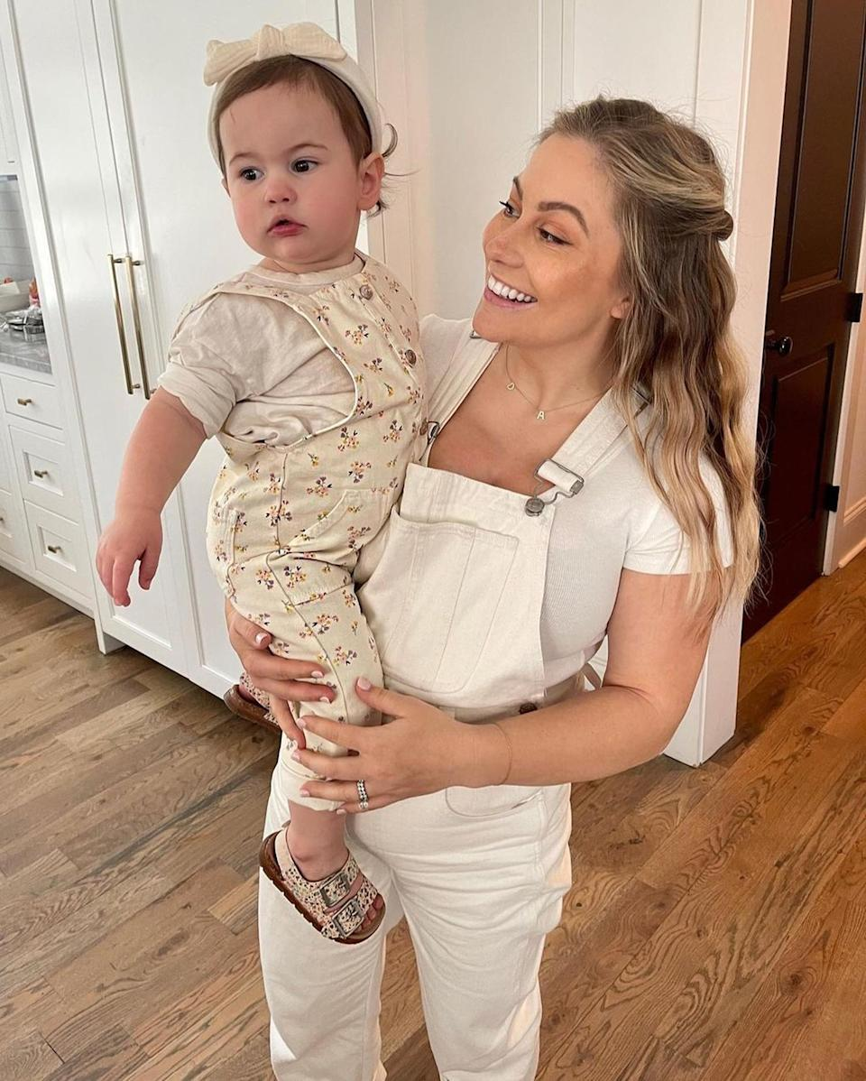 """<p>The pregnant Olympic gynmast smiled big in the kitchen beside daughter Drew Hazel, 1. """"YES, we found out. YES, we are ecstatic,"""" <a href=""""https://www.instagram.com/p/CMp_bPOhy2b/"""" rel=""""nofollow noopener"""" target=""""_blank"""" data-ylk=""""slk:she wrote"""" class=""""link rapid-noclick-resp"""">she wrote</a>, teasing her upcoming sex reveal for her second child with husband Andrew East. </p>"""