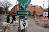 Signs point the way to a nature trail and a new soccer stadium near the home Woody and her grandson share in Washington