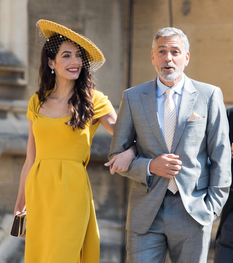 WINDSOR, ENGLAND - MAY 19: George Clooney and Amal Clooney attend the wedding of Prince Harry to Ms Meghan Markle at St George's Chapel, Windsor Castle on May 19, 2018 in Windsor, England. Prince Henry Charles Albert David of Wales marries Ms. Meghan Markle in a service at St George's Chapel inside the grounds of Windsor Castle. Among the guests were 2200 members of the public, the royal family and Ms. Markle's Mother Doria Ragland. (Photo by Pool/Samir Hussein/WireImage)