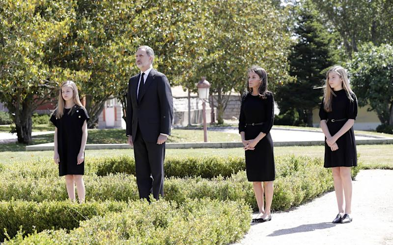 King Felipe and Queen Letizia observing a minute's silence last week with their daughters Princess Leonor (left) and Infanta Sofia (right - AFP