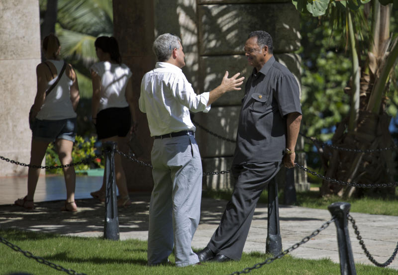 Rev. Jesse Jackson, right, listens to Conrad Tribble, the No. 2 official at the U.S. Interests Section in Havana, outside the Hotel Nacional in Havana, Cuba, Saturday, Sept. 28, 2013. Jackson says he is in town for talks with religious leaders about their concerns for the poor, and peaceful relations between Cuba, the United States and the rest of the Caribbean. Jackson says he also hopes to meet with jailed American government subcontractor Alan Gross. (AP Photo/Ramon Espinosa)