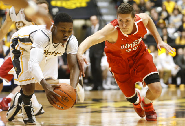 Wichita State's Cleanthony Early, left, and Davidson guard Chris Czerapowicz dive for a loose ball during an NCAA college basketball game at Koch Arena in Wichita, Kan., on Sunday, Dec. 29, 2013. (AP Photo/The Wichita Eagle, Jaime Green)