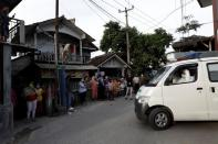 The Wider Image: Volunteer undertakers bear the dead from Indonesian homes as COVID deaths rise