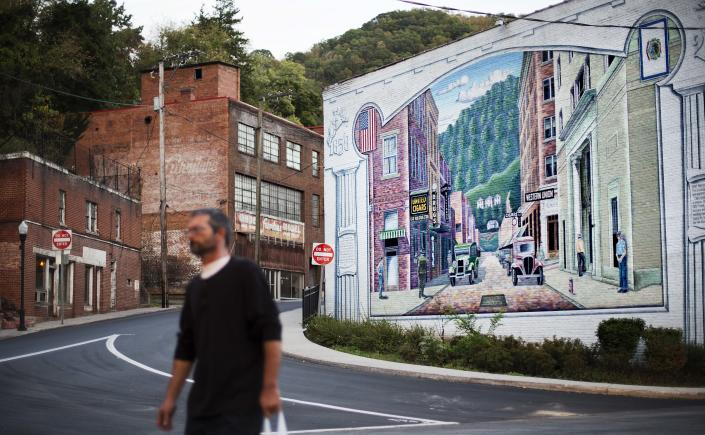 A mural depicting a more vibrant time in the town's history decorates a building in the business district,Oct. 6, 2015, in Welch, W.Va. Poverty experts say these efforts helped relieve the most acute conditions, but did little else. As coal employment declined, people fled because there was little else for them to do. McDowell County, home to Welch, had a population of just under 100,000 in 1950. Since then, the county's population has fallen by four-fifths, to around 20,000. (Photo: David Goldman/AP)