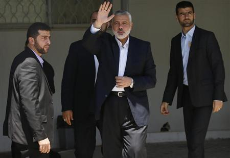 Head of the Hamas government Haniyeh waves outside his office in Gaza City