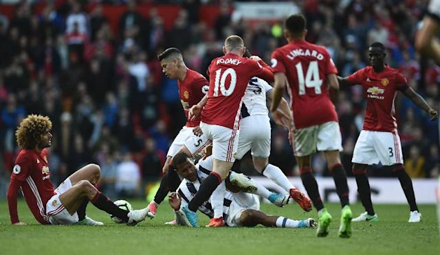 With six key players out due to suspension and injury, Manchester United's draw was a sign of a taxing campaign that may finally be catching up with them (AFP Photo/Oli SCARFF )