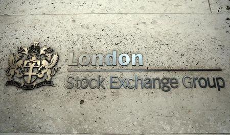 A sign displays the crest and name of the London Stock Exchange in London