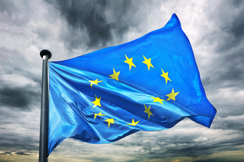 A European union or EU flag against a dark and powerful sky. Photo: Getty
