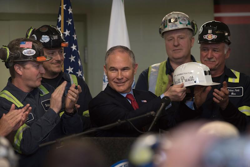 Environmental Protection Agency Administrator Scott Pruitt holds up a miner's helmet that he was given after speaking with coal miners at the Harvey Mine in Sycamore, Pennsylvania, on April 13.