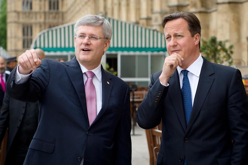 British Prime Minister David Cameron, right, talks with his Canadian counterpart Stephen Harper ahead of Prime Minister Harper's address to the House of Commons in central London, Thursday June 13, 2013. (AP Photo/Leon Neal, Pool)