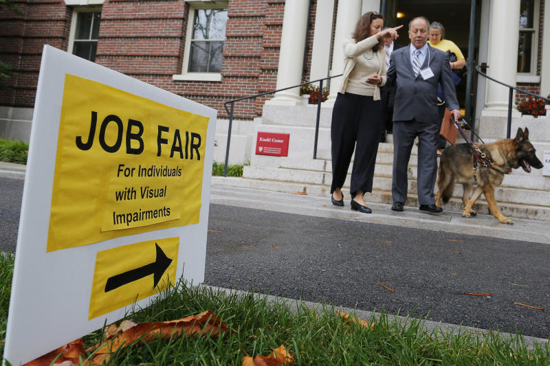 Richard O'Driscoll and his guide dog Maxwell leave the fourth Annual Job Fair for Individuals with Visual Impairments in Cambridge, Massachusetts October 16, 2014. The number of Americans filing new claims for jobless benefits fell to a 14-year low last week, a positive signal for the labor market that could counter doubts over whether the economy is shifting into a higher gear. Organizers of the job fair said that unemployment among those with visual impairments is over 70 percent. REUTERS/Brian Snyder (UNITED STATES - Tags: POLITICS BUSINESS EMPLOYMENT ANIMALS)