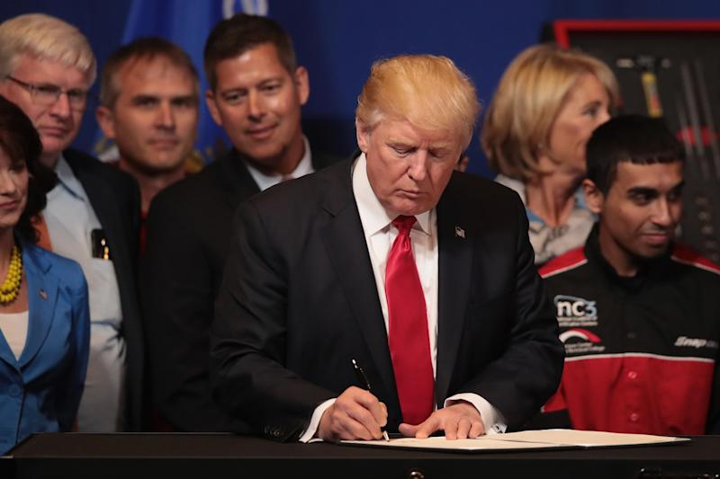 President Donald Trump signs an executive order to revamp the H-1B visa guest worker program: Scott Olson/Getty Images