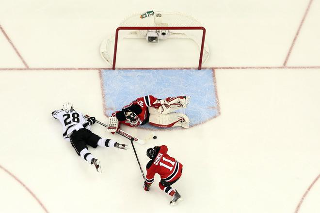 NEWARK, NJ - JUNE 09:  Martin Brodeur #30 of the New Jersey Devils makes a save in front of Jarret Stoll #28 of the Los Angeles Kings and Stephen Gionta #11 during Game Five of the 2012 NHL Stanley Cup Final at the Prudential Center on June 9, 2012 in Newark, New Jersey.  (Photo by Bruce Bennett/Getty Images)