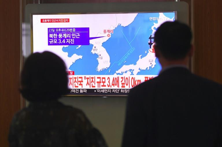 People watch a television news screen at a railway station in Seoul on September 23, 2017 showing a map of the epicenter of an earthquake in North Korea