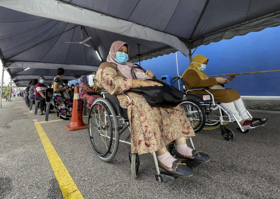A senior citizen awaits her turn for the Covid-19 vaccination at the Dewan Muafakat Taman Adda Height vaccination centre in Johor, May 22, 2021. — Bernama pic