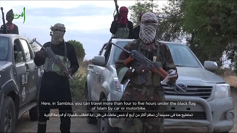 A screen grab taken from a video posted on YouTube on June 2, 2015 by Boko Haram shows an alleged member delivering a speech at an undisclosed location