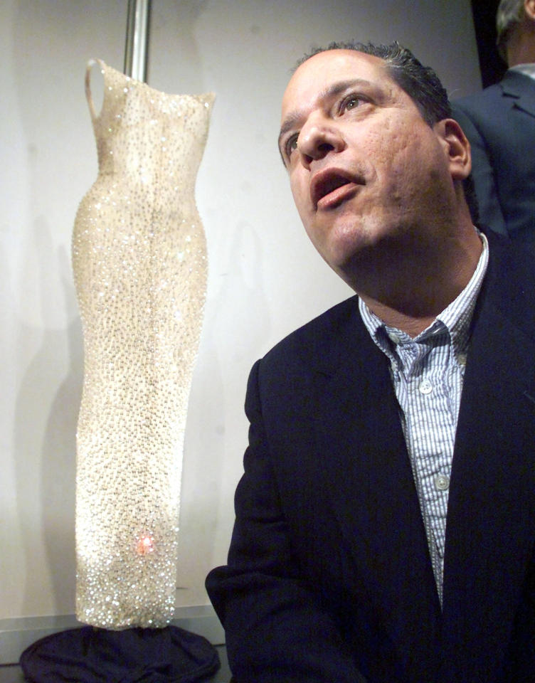 "Peter Siegel, a New York memorabilia dealer, poses with the dress Marilyn Monroe wore to sing ""Happy Birthday"" to President John F. Kennedy, after buying the dress for $1,267,000 at auction at Christie's in New York on October 27. The sale smashed the record price paid for a dress at auction. Monroe was sewn into the form-fitting, flesh-toned dress minutes before her appearance at a May, 1962 birthday fete for Kennedy. Reuters"