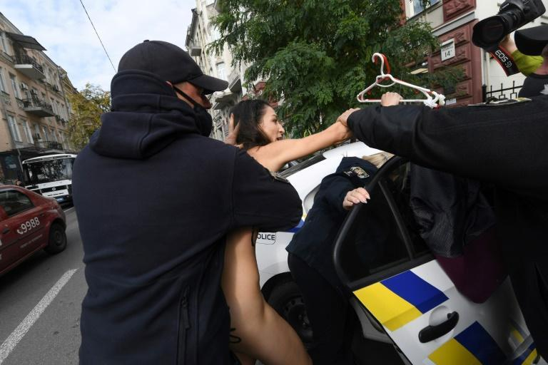 Police officers quickly detained the naked Femen activist