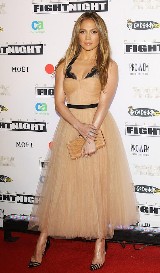 Jennifer Lopez's accessories -- striped pumps and a gold clutch courtesy of Christian Louboutin -- looked fab, but there was something a bit drab about the Maria Lucia Hohan piece she donned at Saturday's Celebrity Fight Night XIX in Phoenix, Arizona. Not only did the halterneck dress look as though the former Fly Girl was wearing a strapless frock over an exposed black bra, the nude hue completely washed her out. The voluminous tulle skirt also seemed slightly immature for the 43-year-old mother of two. (3/23/2013)
