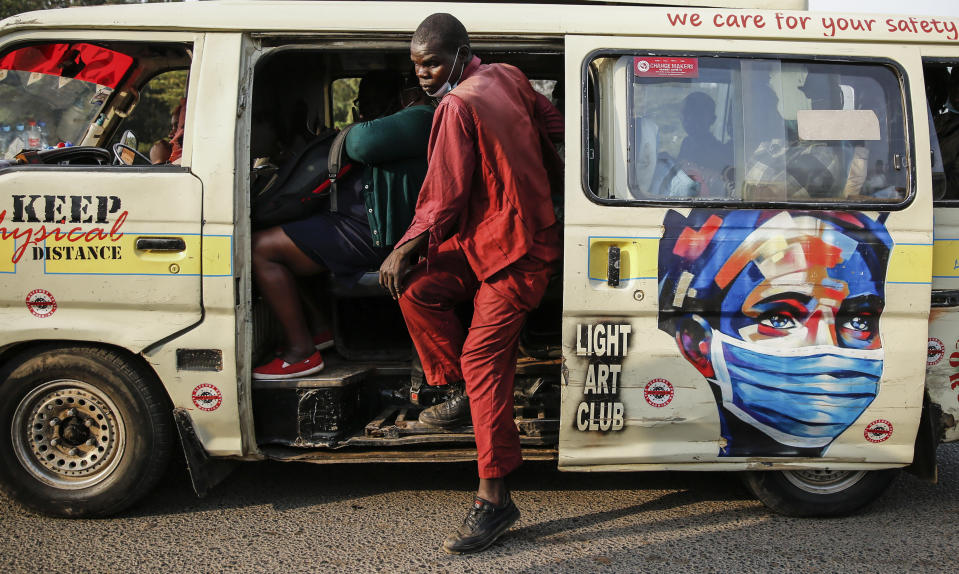 A matatu, or public minibus, displays an informational painting instructing people to wear masks to curb the spread of the coronavirus, in the low-income Kibera neighborhood of Nairobi, Kenya, Saturday, June 12, 2021. Africa has recorded more than 5 million confirmed COVID-19 cases, including 135,000 deaths. That is a small fraction of the world's caseload, but many fear the crisis could get much worse. (AP Photo/Brian Inganga)
