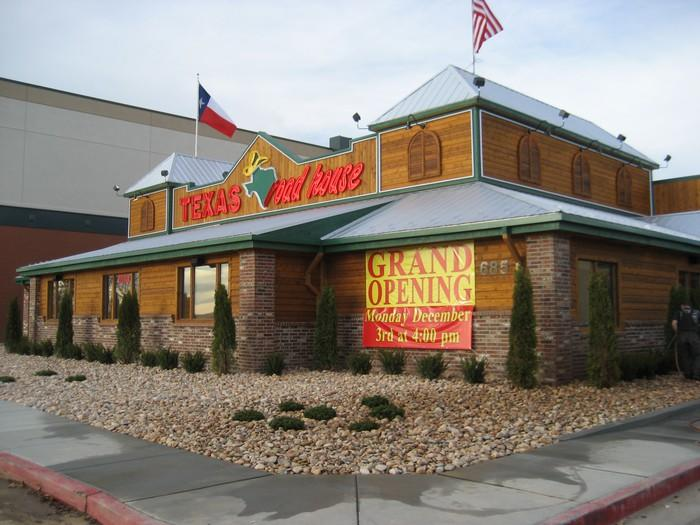 Exterior shot of a Texas Roadhouse during its grand opening in Utah.
