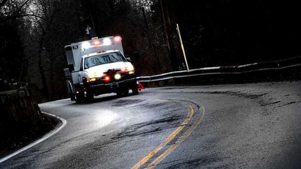 PHOTO: An ambulance with flashing lights alongside a road in this stock photo. (STOCK PHOTO/Getty Images)