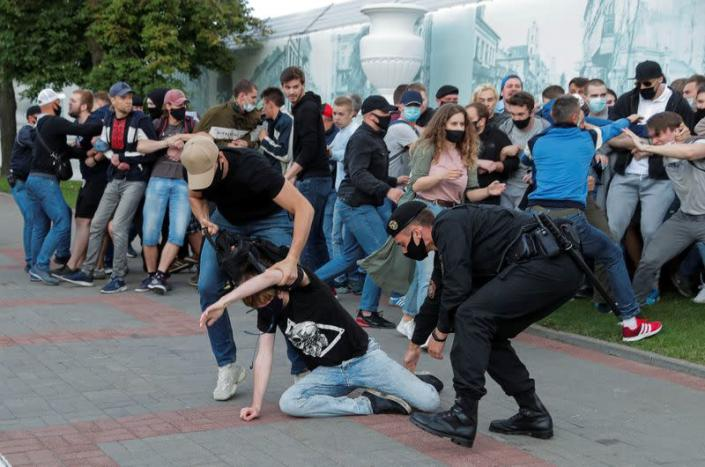 Law enforcement officers detain participants of a protest after the Belarusian election commission refused to register Viktor Babariko and Valery Tsepkalo as candidates for the upcoming presidential election in Minsk