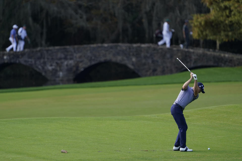 Justin Thomas hits on the 12th hole during the second round of the Masters golf tournament Friday, Nov. 13, 2020, in Augusta, Ga. (AP Photo/David J. Phillip)