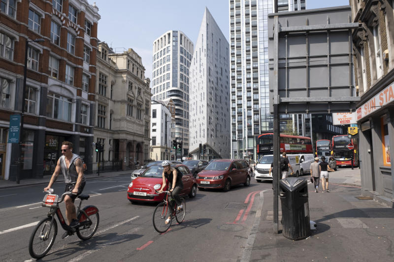 Cars and cyclists pass through the Silicon Roundabout area, a technology cluster of high-tech companies located in Shoreditch and St. Lukes in East London. (Credit: Mike Kemp/Getty Images)