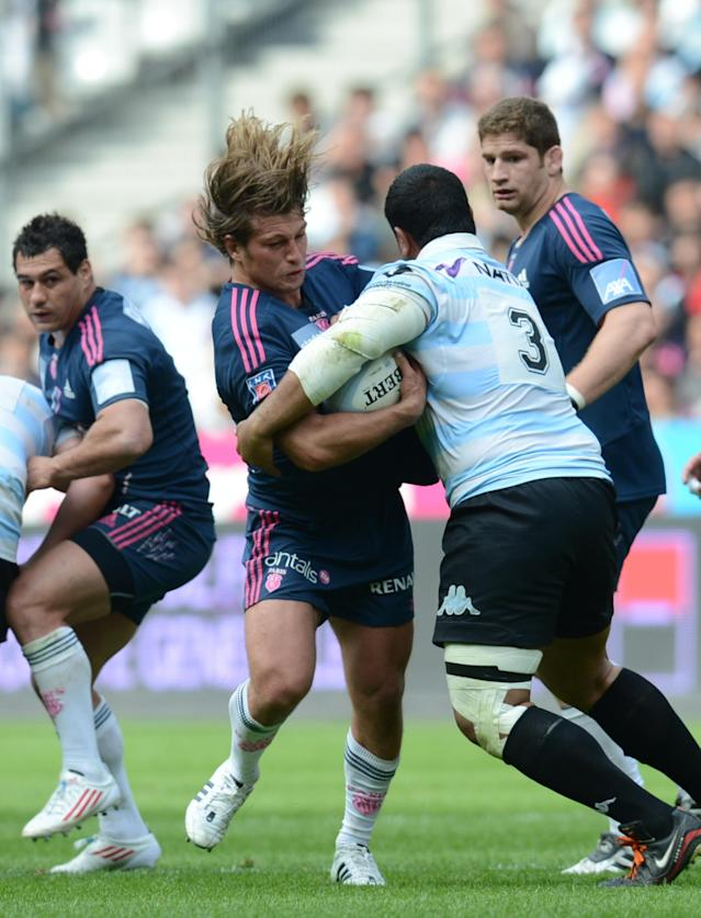 Stade Francais' French hooker Dimitri Szarzewski (C) vies with Racing Métro's prop from New Zealand Benjamin Sa (2ndR) during the French Top 14 rugby union match Stade Francais vs. Racing Metro on May 5, 2012 at the Charlety stadium in Paris. AFP PHOTO / FRANCK FIFEFRANCK FIFE/AFP/GettyImages