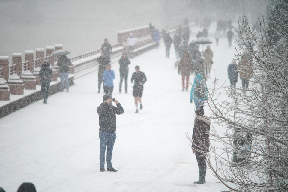 People walking in the snow in Battersea Park, London. Picture date: Sunday January 24, 2021. (Photo by Aaron Chown/PA Images via Getty Images)
