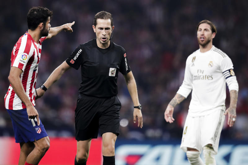 MADRID, SPAIN - SEPTEMBER 28: (L-R) Diego Costa of Atletico Madrid, referee Gonzalez Gonzalez, Sergio Ramos of Real Madrid during the La Liga Santander match between Atletico Madrid v Real Madrid at the Estadio Wanda Metropolitano on September 28, 2019 in Madrid Spain (Photo by David S. Bustamante/Soccrates/Getty Images)