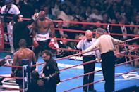 <p>Evander Holyfield has his right ear checked by after he was bit in the ear by Mike Tyson in the third round of their WBA Heavyweight match Saturday, June 28, 1997, at the MGM Grand in Las Vegas. </p>