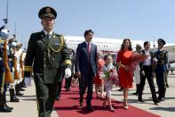 Prime Minister Justin Trudeau, his wife Sophie Gregoire Trudeau, and daughter Ella-Grace arrive in Beijing, China, on Aug. 30, 2016. THE CANADIAN PRESS/Adrian Wyld